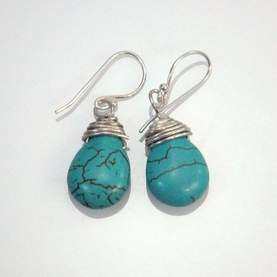 Silver earrings with turquoise precious stones