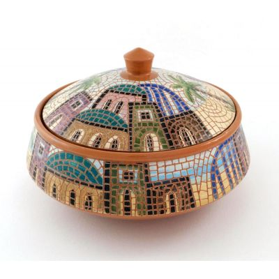 Handmade red ceramic serving bowl painted with traditional village scene